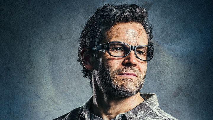 Model wearing Specsavers safety eyewear