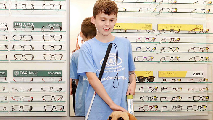 Vision Express child volunteer with guide dog