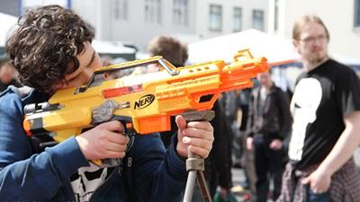 A man holding a Nerf gun