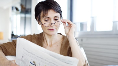 Woman reads newspaper