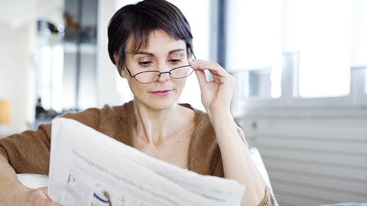 Woman reads newspaper
