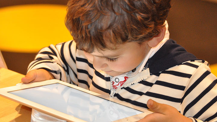 A child using a tablet device
