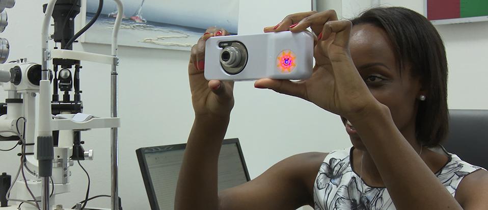 Belinda Babumba using the Volk Eye Check