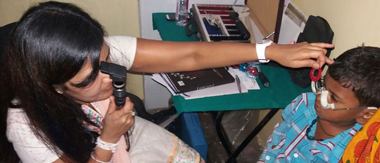 Rajula Karania treating a patient in Bihar, India