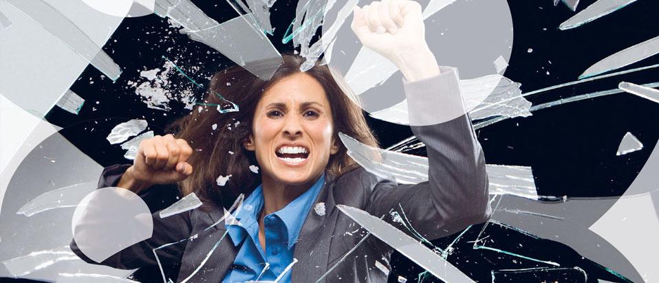 Business woman smashing glass