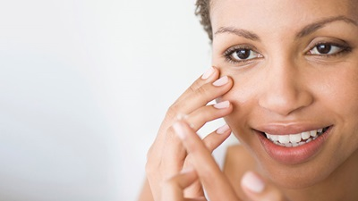 Lady putting contact lens in