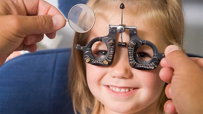A child having her sight tested