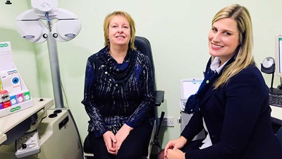 Optometrist director at Specsavers Brownhills, Justine Page, and her patient, Margaret O'Reilly
