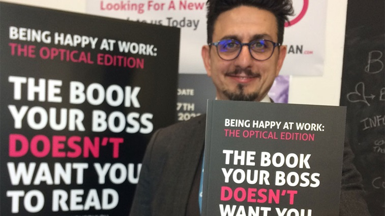 Garry Kousoulou with his book Being Happy at Work: the Optical Edition