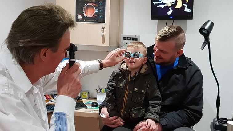 Peter Frampton using a retinoscope