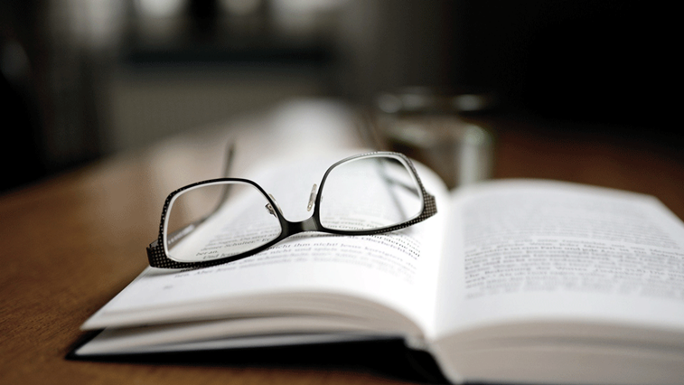 glasses on open book