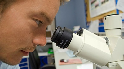 man looking into lens