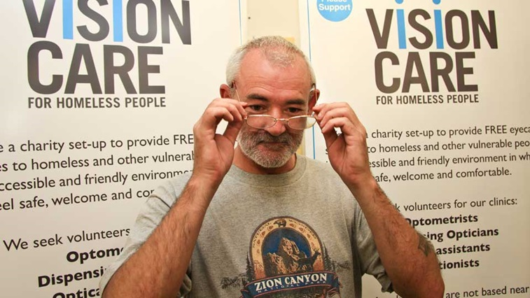 Man trying on spectacles at VCHP