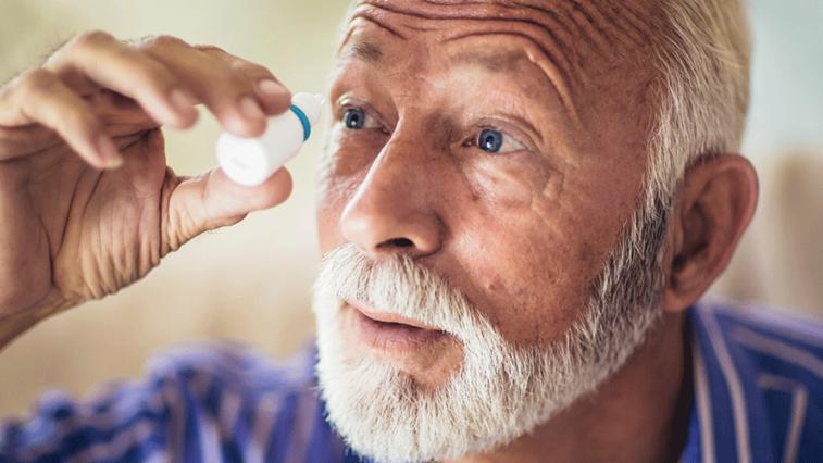 patient applying eye drops