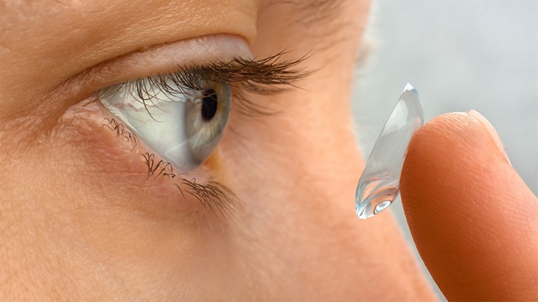 Person inserting a contact lens