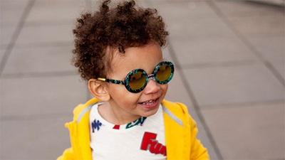 Child wearing Zoobug London sunglasses