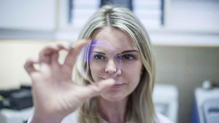 Woman holding lens