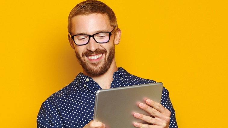 Man on tablet device