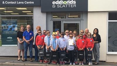Edmonds and Slatter staff pictured with a group of children from Belarus