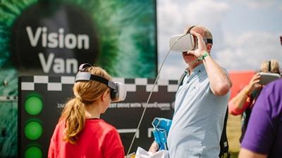 Vision Van patients use virtual reality headsets