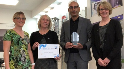 Lunettes Opticians receiving award