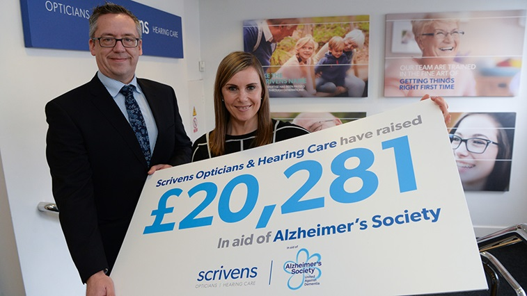 Scrivens presents the Alzheimer's Society with a cheque