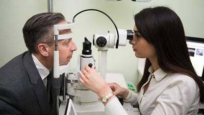 Specsavers optometrist performing sight test