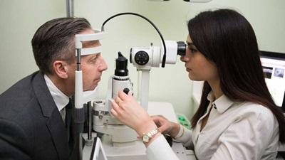 Specsavers optometrist performing sight test
