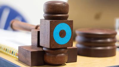 gavel with OT logo