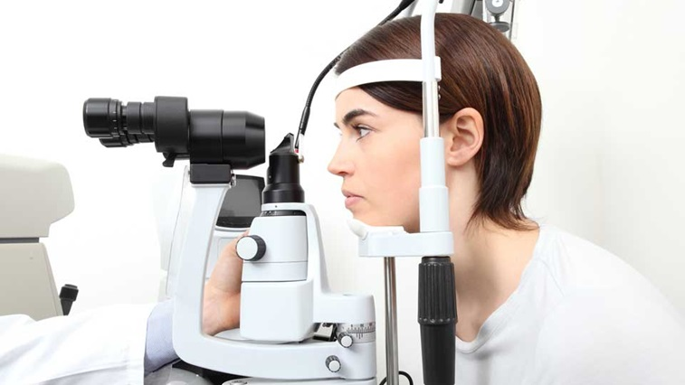 Lady at optometry equipment
