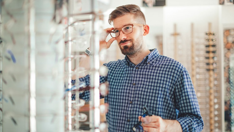 male trying on glasses