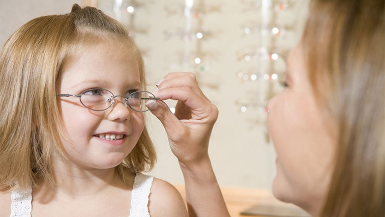 A child having spectacles fitted