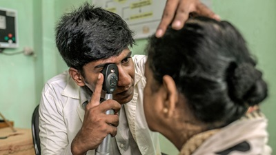 Man performing vision screening
