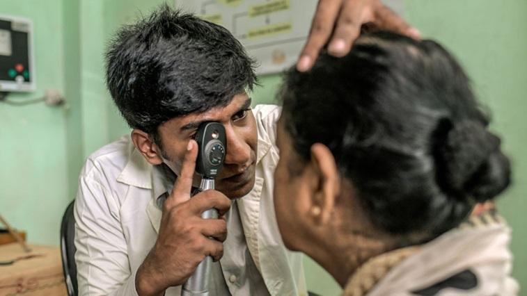 Man performing vision screening