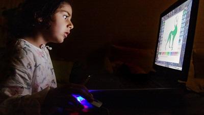 Girl on computer screen