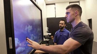 Man using a touch screen machine