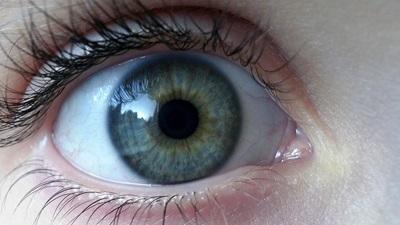 Wide open blue eye