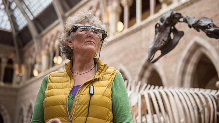 A women wearing OxSight electronic glasses