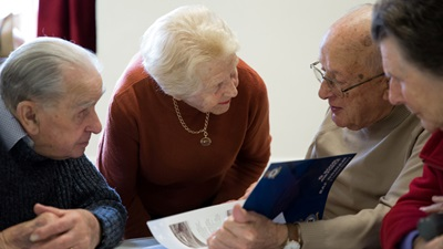 elderly group talking