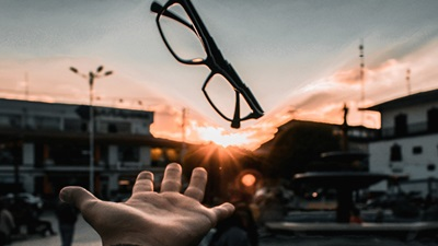 hand and glasses