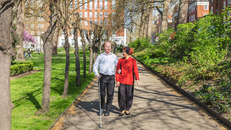 visually impaired person with woman
