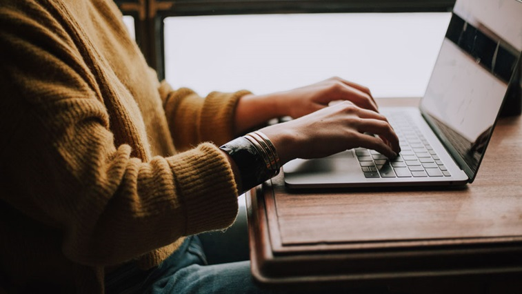 hands placed on laptop