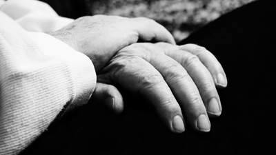 Black and white image of hands
