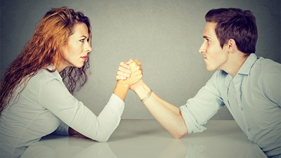 Women and man wrestle