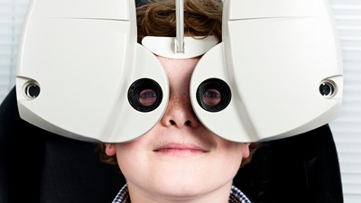 Boy having a sight test