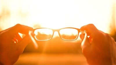 Person holding glasses up