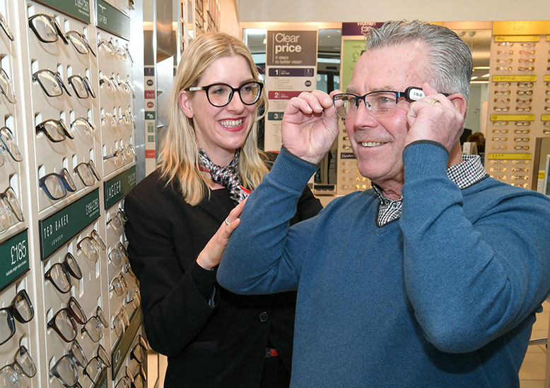 Micheal Vines trying on spectacles in Vision Express