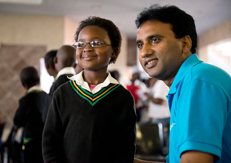 A child pictured (left) and Professor Kovin Naidoo pictured (right)
