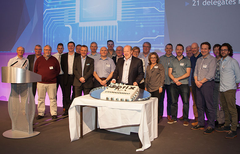 The Optix team celebrate milestone with a cake