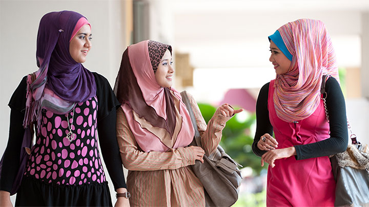 Three ladies wearing hijab